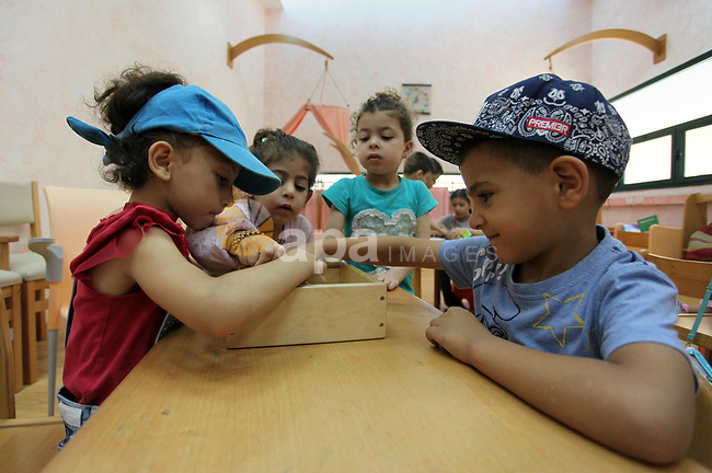 Palestinian children enjoy as part of the activities during a summer holiday, at Qattan Foundation in Gaza city, on June 21, 2018. Photo by Mahmoud Ajour