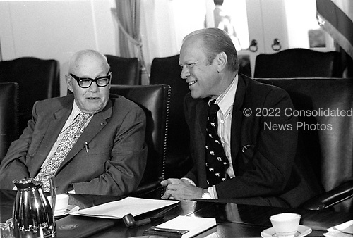 """United States President Gerald R. Ford, right, meets with George Meany, president of the American Federation of Labor–Congress of Industrial Organizations (AFL-CIO), left in the Cabinet Room of the White House in Washington, DC on Tuesday, August 26, 1975.  They were meeting with other union leaders to discuss grain sales to the U.S.S.R. and related US maritime policy.<br /> Credit: Benjamin E. """"Gene"""" Forte / CNP"""