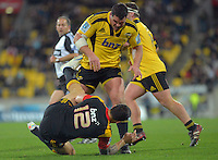 Referee Jonathan Kaplan (rear left) watches Ben May drop Sonny Bill Williams before yellow carding him during the Super 15 rugby match between the Hurricanes and Chiefs at Westpac Stadium, Wellington, New Zealand on Friday, 13 July 2012. Photo: Dave Lintott / lintottphoto.co.nz