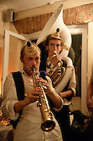 Members of the group Brass Band Without Borders playing the oboe and sousaphone at a cafe in Istanbul, Turkey