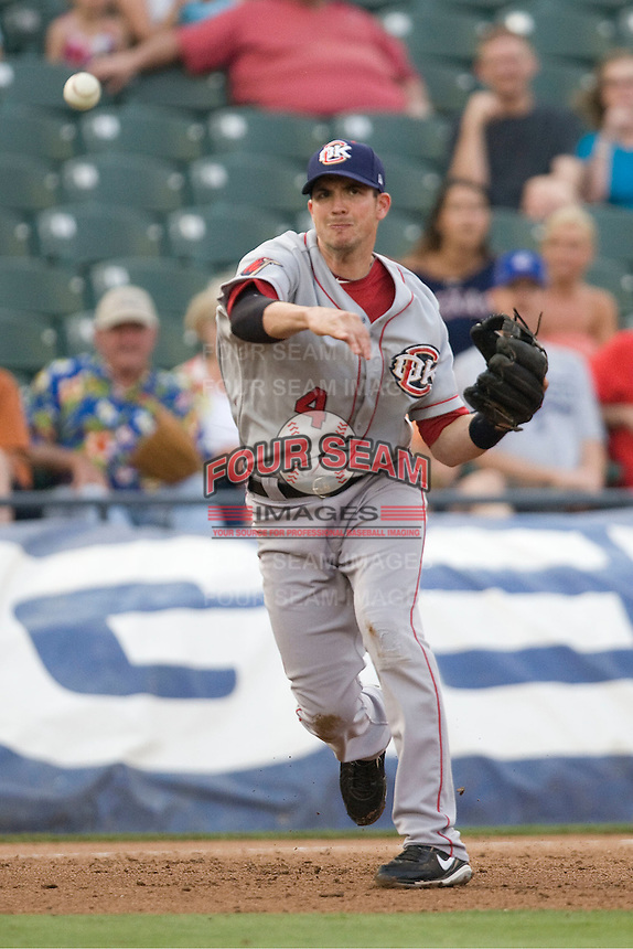 Thirdbaseman Tommy Manzella #4 of the Oklahoma City RedHawks throws to first against the Round Rock Express on April 26, 2011 at the Dell Diamond in Round Rock, Texas. (Photo by Andrew Woolley / Four Seam Images)