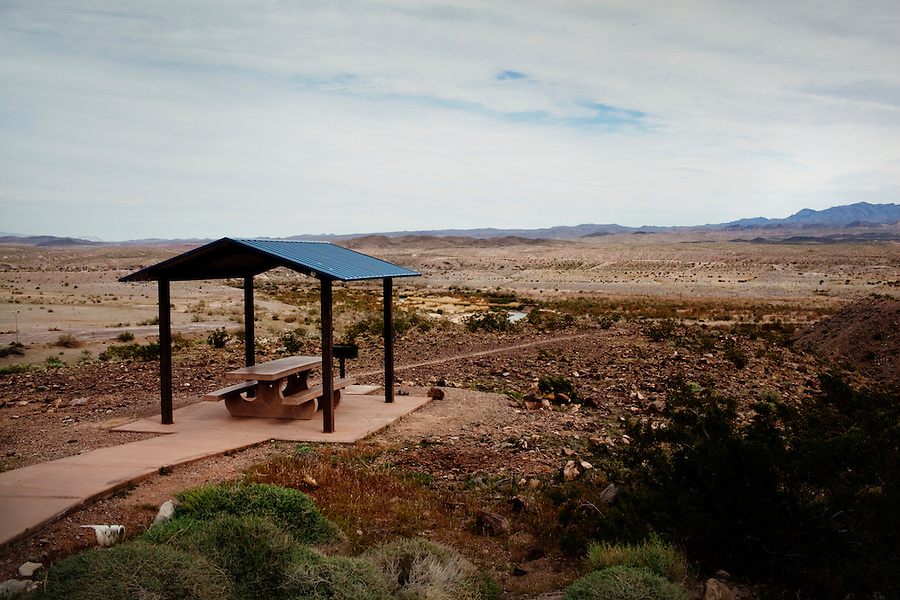CREDIT: Daryl Peveto / LUCEO for The Wall Street Journal.Photo Assignment ID: 11416 Slug: LAKEMEAD ..Lake Mead, Nevada, March 16, 2011 - A view of a lone picnic table at a receded Las Vegas Bay on Lake Mead. When water levels are normal, the dry basin in the distance is filled with water. Lake Mead has been one of America's most popular recreation areas, with a 12-month season that attracts more than 9 million visitors each year for swimming, boating, skiing, fishing and other outdoor pursuits. Currently it is experiencing a 10 year drought that has diminished the water to levels not seen since the lake was created. ..Lake Mead is the largest water reservoir in the United States. Located on the Colorado River southeast of Las Vegas, it is the major reserve for Nevada, California and Arizona. The city of Las Vegas alone gets 90% of its water from Lake Mead. The lake is currently experiencing a ten year drought, recently dropping to1,083 feet - its lowest level since it was dammed in the 1930s. If it drops further, there is the potential for cutoffs of water for hydro-electricity, agriculture and cities across the Southwest. The current level is near emergency level: if drops to 1075, the Secretary of Interior will have to declare a severe water emergency and major cutbacks will ensue. If gets below 1025, all water for hydro from Hoover Dam shut off. If it falls below 1,000 feet the intake valves that pull water from the Lake for consumption will no longer be operational.