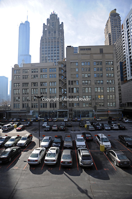 The Chicago Tribune parking lot, now more valuable than the paper itself, is seen in downtown Chicago, Illinois on March 6, 2009.  With $13 billion in debt, the parking lot adjacent to The Chicago Tribune is more valuable than the newspaper itself and is one of many assets owner Sam Zell hopes to sell, including the Chicago Cubs baseball team.