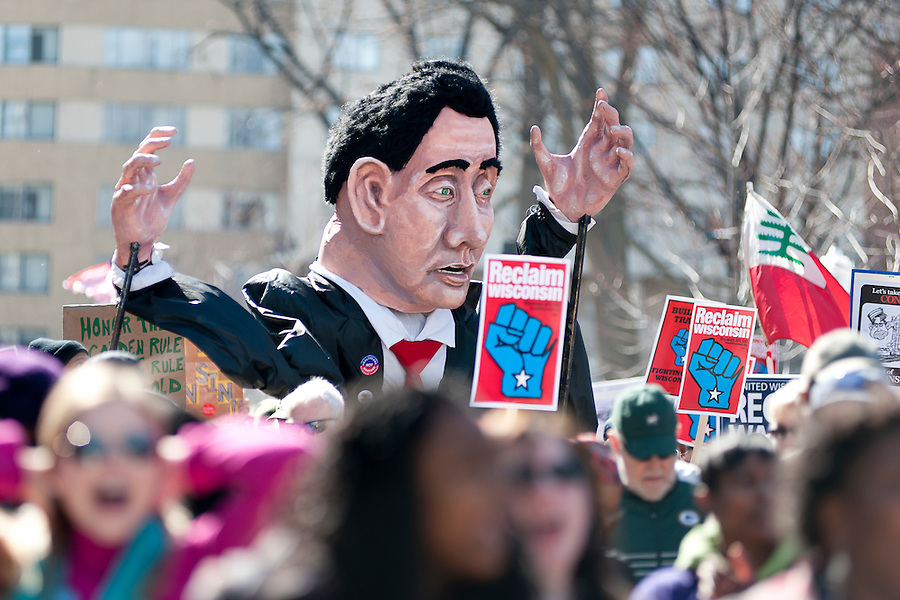 A caricature of Wisconsin Gov. Scott Walker is pictured as more than 60,000 citizens, public workers, teachers and union members gathered during a Reclaim Wisconsin protest rally held outside the Wisconsin State Capitol in Madison, Wis., on March 10, 2012. One year earlier, Wisconsin's Republican-controlled legislature pushed through Gov. Scott Walker's bill to strip unions and public workers of many collective bargaining rights. (Photo by Jeff Miller for SEIU)