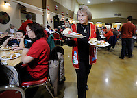 NWA Media/ J.T. Wampler - Janice Payne of Springdale serves guests at the Springdale Senior Center Thursday Dec. 25, 2014. Around 100 people were served a traditional meal of turkey, stuffing and the trimmings.