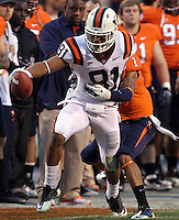 CHARLOTTESVILLE, VA- NOVEMBER 12: Cornerback Demetrious Nicholson #1 of the Virginia Cavaliers tackles wide receiver Jarrett Boykin #81 of the Virginia Tech Hokies during the game on November 28, 2011 at Scott Stadium in Charlottesville, Virginia. Virginia Tech defeated Virginia 38-0. (Photo by Andrew Shurtleff/Getty Images) *** Local Caption *** Jarrett Boykin;Demetrious Nicholson