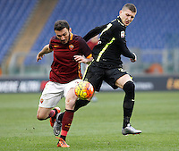 Calcio, Serie A: Roma vs Hellas Verona. Roma, stadio Olimpico, 17 gennaio 2016.<br /> Roma&rsquo;s Vasileios Torosidis, left, and Hellas Verona&rsquo;s Ante Rebic fight for the ball during the Italian Serie A football match between Roma and Hellas Verona at Rome's Olympic stadium, 17 January 2016.<br /> UPDATE IMAGES PRESS/Isabella Bonotto