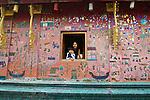 Mother and son at Wat Keong Tong in Luang Prabang, Laos