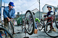 Sandro Souza, 29, makes a living fixing flats and otherwise getting broken bicycles moving again in the Santa Terezina neighborhood in Porto Alegre. It is home to a number of participants in the Casa Fonte Colombo programs. The neighborhood was once a slum of ramshackle shacks until the government stepped in and redeveloped the area with decent housing for the poor. About 1,500 families now live in decent housing.