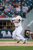 Tyler Saladino (8) of the Charlotte Knights lines a base hit to right field during the bottom of the first inning against the Norfolk Tides at BB&T BallPark on April 9, 2015 in Charlotte, North Carolina.  The Knights defeated the Tides 6-3.   (Brian Westerholt/Four Seam Images)