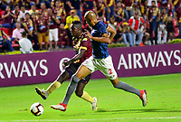 IBAGUE- COLOMBIA, 03-04-2019: Marco Pérez de Deportes Tolima (COL) disputa el balón con Alex Silva de Jorge Wilstermann (BOL), durante partido de la fase de grupos, grupo G, fecha 3, entre Deportes Tolima (COL) y Jorge Wilstermann (BOL), por la Copa Conmebol Libertadores 2019, en el Estadio Manuel Murillo Toro de la ciudad de Ibague. / Marco Perez of Deportes Tolima (COL) vies for the ball with Alex Silva of Jorge Wilstermann (BOL), during a match of the groups phase, group G, 3rd date, beween Deportes Tolima (COL) and Jorge Wilstermann (BOL), for the Conmebol Libertadores Cup 2019, at the Manuel Murillo Toro Stadium, in Ibague city. VizzorImage / Juan Carlos Escobar / Cont.
