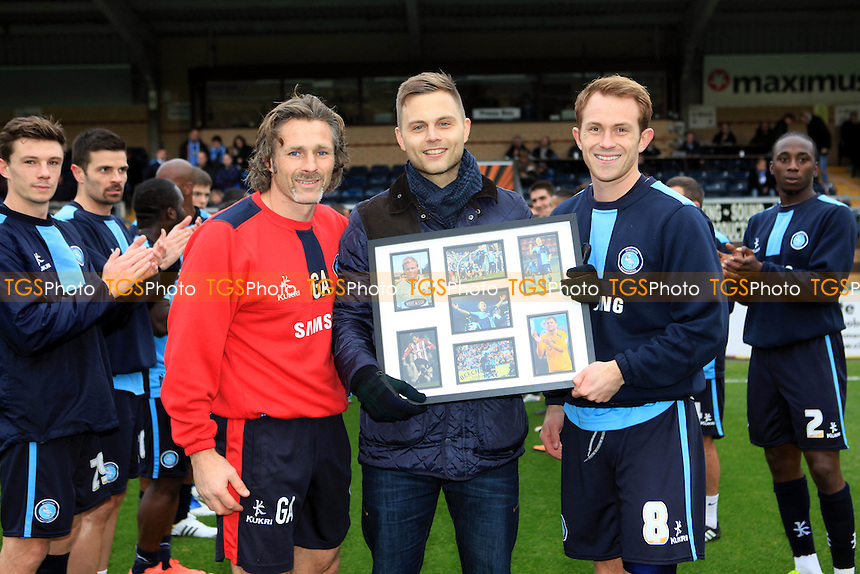 Wycombe manager, Gareth Ainsworth and captain, Stuart Lewis present Danny Foster with a gift to mark his announcement that he is retiring from football due to injury  - Wycombe Wanderers vs Cheltenham Town - Sky Bet League Two Football at Adams Park, High Wycombe, Buckinghamshire - 16/11/13 - MANDATORY CREDIT: Paul Dennis/TGSPHOTO - Self billing applies where appropriate - 0845 094 6026 - contact@tgsphoto.co.uk - NO UNPAID USE