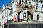 Male worker operating mechanical grabber machine