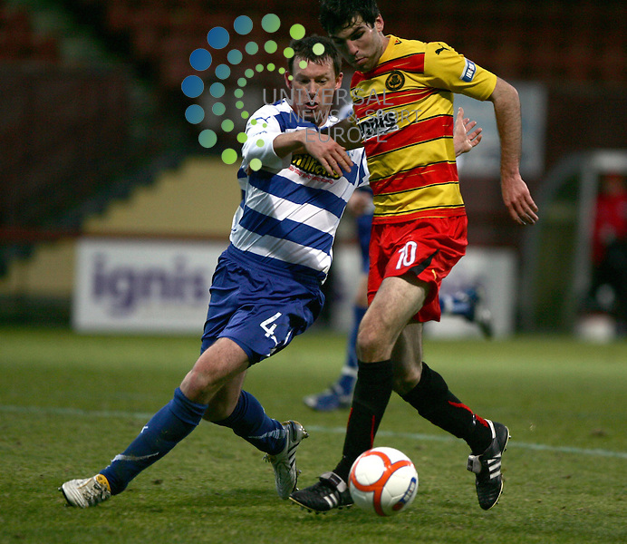 Partick Thistle v Greenock Morton.Firhill Stadium.Saturday 13th November -  2010 Score .Irn Bru 1st Division.Martin Grehan shields the ball from Staurt McCaffrey.www.universalnewsandsport.com.(0ffice) 0844 884 51 22...