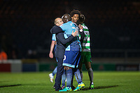 Adebayo Akinfenwa of Wycombe Wanderers embraces Yeovil Town Manager Darren Way after the Sky Bet League 2 match between Wycombe Wanderers and Yeovil Town at Adams Park, High Wycombe, England on 14 January 2017. Photo by Andy Rowland / PRiME Media Images.