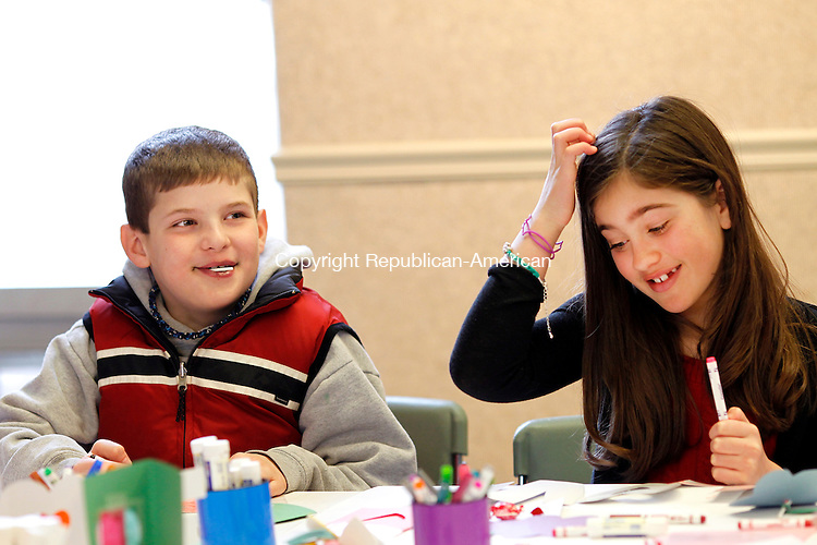 Litchfield, CT- 14, February 2011-021411CM02 Nick Dematteis, 9 and Faye Devaux, 8 both of Litchfield, share a laugh while making Valentines Day cards at The Oliver Wolcott Library in Litchfield Monday afternoon.  The craft party, in it's second year, was put on by Children's Librarian, Lisa Shaia.  For more information on upcoming events, log onto http://www.owlibrary.org.   Christopher Massa Republican-American