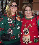Amber and Jessica during the Ugly Sweater Wine Walk in downtown  Reno on Saturday, Dec. 16, 2017.
