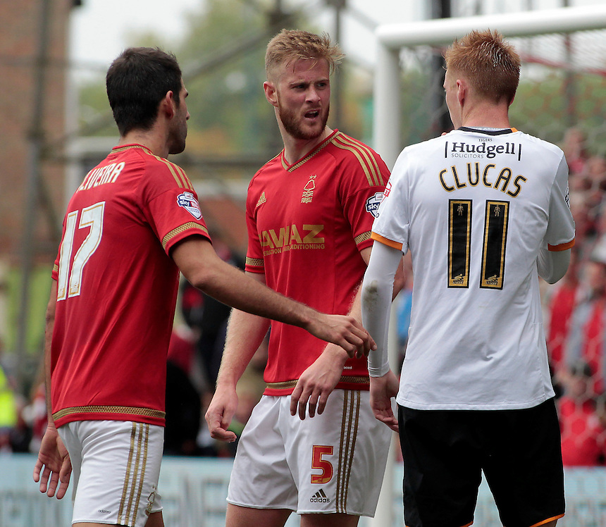 Nottingham Forest's Matthew Mills squares up to Hull City's Sam Clucas<br /> <br /> Photographer David Shipman/CameraSport<br /> <br /> Football - The Football League Sky Bet Championship - Nottingham Forest v Hull City - Saturday 3rd October 2015 - The City Ground - Nottingham<br /> <br /> &copy; CameraSport - 43 Linden Ave. Countesthorpe. Leicester. England. LE8 5PG - Tel: +44 (0) 116 277 4147 - admin@camerasport.com - www.camerasport.com