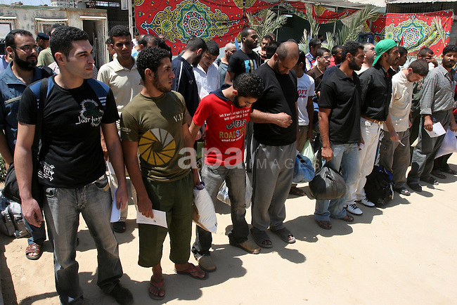 Palestinian prisoners stand at a Hamas controlled prison in Gaza City moments before their release on August 11, 2010 following a Hamas? decision to free prisoners for the occasion of the Muslim holy month of Ramadan. Photo by Mohammed Asad