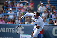Washington, DC - August 3, 2014: Milos Raonic of Canada returns the ball to fellow Canadian Vasek Pospisil in the Citi Open final, August 3, 2014. Raonic won in straight sets over Pospisil.   (Photo by Don Baxter/Media Images International)
