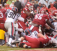 NWA Media/Michael Woods --11/22/2014-- w @NWAMICHAELW...University of Arkansas runningback Jonathan Williams pushes past the Ole Miss defense to score a touchdown in the 1st quarter of Arkansas 30-0 win over Ole Miss during Saturdays game at Razorback Stadium.