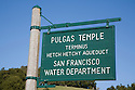 Sign at the entrance to the Pulgas Water Temple. The Temple celebrates the terminus of the of the water system that brings water from Hetch Hetchy in Yosemite National Park to the San Francisco area for drinking water. Woodside, California