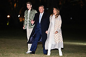 United States President Donald J. Trump waves to the media as he, first lady Melania Trump and son Barron Trump arrive at the White House in Washington, DC on January 5, 2020. Trump is back at the White House after he spent 2 weeks at his resort, Mar-a-Lago in West Palm Beach, Florida for the holidays.<br /> Credit: Oliver Contreras / Pool via CNP