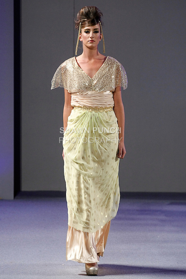 Model walks runway in an outfit from the Citrolina Designs collection by Citra Gala, during Couture Fashion Week Spring 2013 in NYC, on September 16, 2012.