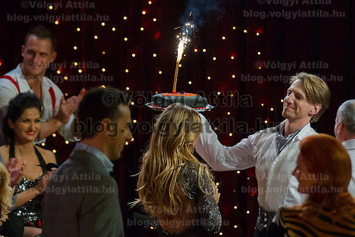 Mate Meszaros celebrates his birthday in the live broadcast celebrity dancing talent show Saturday Night Fever by Hungarian television company RTL II in Budapest, Hungary on March 16, 2013. ATTILA VOLGYI