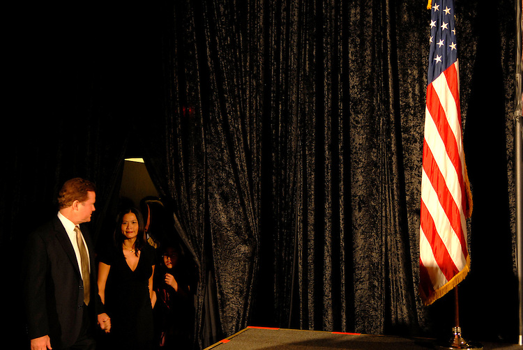 Virginia Senatorial Candidate Jim Webb, joined by his wife Hong Lee, make their way to the stage to speak to his supporters, saying he won this extremely close contest with current Sen. George Allen, R-VA, on November 7, 2006 in Tysons, Virginia.