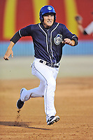 Asheville Tourists shortstop Pat Valaika #16 runs to third during opening night game against the Delmarva Shorebirds at McCormick Field on April 3, 2014 in Asheville, North Carolina. The Tourists defeated the Shorebirds 8-3. (Tony Farlow/Four Seam Images)