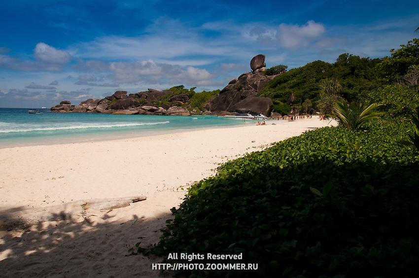 Similan Island panorama with sail rock and white sand beach