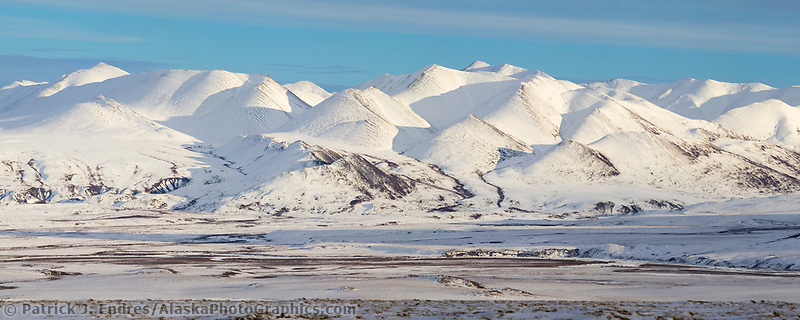 Panorama of the snow covered Philip Smith Mountains of the Brooks Range, Arctic Alaska