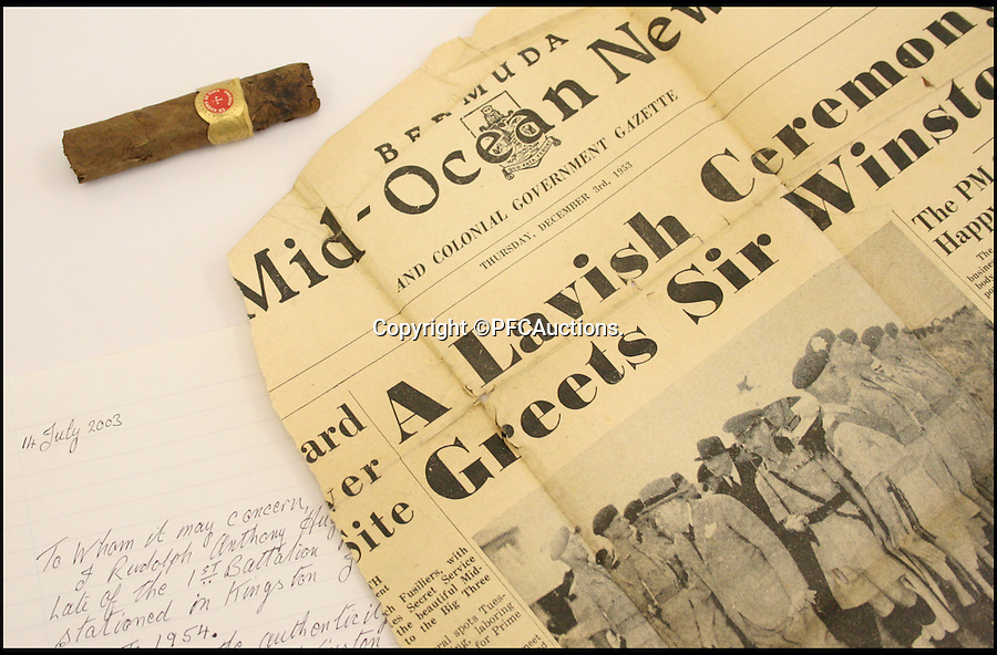 BNPS.co.uk (01202 558833)<br /> Pic: PFCAuctions/BNPS<br /> <br /> ***Please Use Full Byline***<br /> <br /> Sir Winston Churchill's partly smoked cigar. <br /> <br /> A CIGAR half-smoked by Winston Churchill during a Cold War meeting with world leaders is going up for sale.<br /> <br /> A soldier guarding the room of Churchill, US President Dwight Eisenhower and French Premier Joseph Laniel at the three-power conference held in Bermuda in 1953 collected the still-smoking cigar when he was sent in with others to tidy up after the meeting had ended.<br /> <br /> The La Aroma de Cuba cigar, which Churchill was known to smoke alongside his more famous Romeo y Julieta brand, is about three-and-a-half inches long.<br /> <br /> The cigar is sold with a letter of provenance from the soldier, Rudolph Hughes, who was serving with 1st Battalion Royal Welch Fusiliers in Jamaica when he got sent to Hamilton, Bermuda to guard some of the world's most important men of the time.<br /> <br /> Acting Provo Sgt Hughes guarded the main conference room for several hours, armed with a machine gun, alongside two FBI men.<br /> <br /> As well as the letter of provenance, the cigar also comes with various Bermudian press cuttings and Hughes' Bermudian driving licence.<br /> <br /> The auction is being held by PFC Auctions and bidding is open until 7pm on October 1. The opening bid is £240 but it is expected to sell for £2,000 to £3,000.