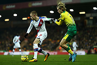 1st January 2020; Carrow Road, Norwich, Norfolk, England, English Premier League Football, Norwich versus Crystal Palace; Max Meyer of Crystal Palace holds off Todd Cantwell of Norwich City - Strictly Editorial Use Only. No use with unauthorized audio, video, data, fixture lists, club/league logos or 'live' services. Online in-match use limited to 120 images, no video emulation. No use in betting, games or single club/league/player publications