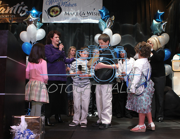 Nevada First Lady Kathleen Sandoval and her daughter Marisa, left, acknowledge Gunner and Garrett Gouldsmith during the Make-A-Wish Foundation Waffles & Wishes event at the Atlantis Casino Resort, in Reno, Nev., on Tuesday, March 27, 2012. Their sister Gabby Gouldsmith, 8, who suffers from an auto-immune deficiency disorder, received a bedroom makeover from the organization..Photo by Cathleen Allison
