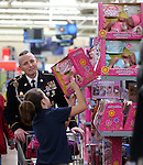 Nearly 170 elementary students shopped with the Holiday with a Hero program at Walmart in Carson City, Nev., on Tuesday, Dec. 17, 2013. The community event partners military, firefighters, law enforcement and medical personnel with local Students in Transition to provide them with Christmas presents.<br /> Photo by Cathleen Allison
