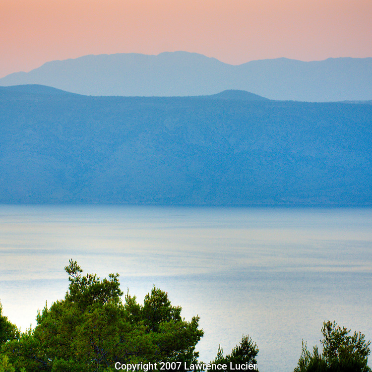 At Konoba Humac, outdoor dining is enhanced by the view of the island Brac across the channel from Hvar. Due to the restaurant's mountaintop location, guest have their choice of views towards Brac or the mainland.  (c) 2007 www.lawrencelucier.com