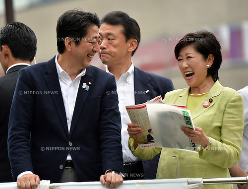 July 4, 2013, Tokyo, Japan - Japan's Prime Minister Shinzo Abe and Yuriko Koike, vice chairperson of the Liberal Democratic Party's election committee, have something to laugh about during Abe's stumping tour for a local candidate at Tokyo's Ikebukuro area on Thursday, July 4, 2013, as campaigning for the July 21 upper house election officially kicks off. <br /> <br /> Contested are half the 242seats in less powerful upper house of parliament that could make or break the Abe administration and Abenomics, his economic-revival plan.  (Photo by Natsuki Sakai/AFLO)