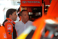 Apr 25, 2008; Talladega, AL, USA; NASCAR Sprint Cup Series driver Tony Stewart (left) talks with Andy Graves during practice for the Aarons 499 at Talladega Superspeedway. Mandatory Credit: Mark J. Rebilas-US PRESSWIRE