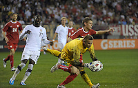 Poland goalkeeper Artur Boruc (1) makes a save in front of US forward Jozy Altidore (17).  The U.S. Men's National Team tied Poland 2-2 at Soldier Field in Chicago, IL on October 9, 2010.