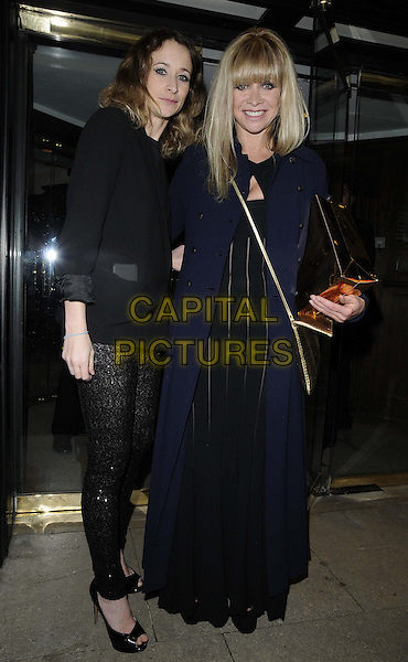 "Leah Wood & Jo Wood.attended Jo Wood's ""Hey Jo"" book launch party, Liberty London, Regent St., London, England..February 27th, 2013.full length blue long coat black dress lace leggings blazer mother mom um daughter family gold strap blazer top.CAP/CAN.©Can Nguyen/Capital Pictures."
