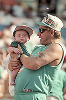 MIAMI, FL - DEC 19, 1999:  A young fan and an old fan watch the Miami Dolphins defeat the San Diego Chargers 12-9 at Joe Robbie Stadium, in Miami, FL. (Photo by Brian Cleary/www.bcpix.com)