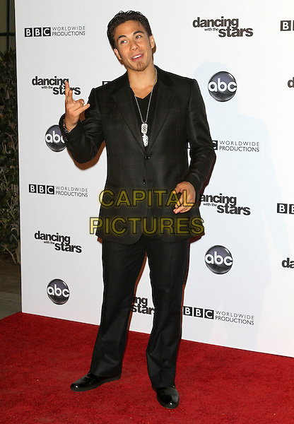 APOLO ANTON OHNO.'Dancing With The Stars' 200th Episode held at Boulevard 3, Hollywood, CA, USA..November 1st, 2010.full length black suit hand.CAP/ADM/FS.©Faye Sadou/AdMedia/Capital Pictures.