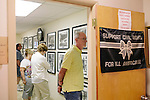 A tour group looks at historic photos in the basement of16th Street Baptist Church on August 13, 2013 in downtown Birmingham, Alabama. In 1963, four girls were killed when a bomb under the church's side steps went off.