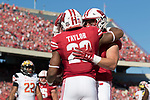 Wisconsin Badgers running back Jonathan Taylor (23) celebrates a touchdown during an NCAA Big Ten Conference football game against the Maryland Terrapins Saturday, October 21, 2017, in Madison, Wis. The Badgers won 38-13. (Photo by David Stluka)