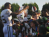 Brandon Marshall #15, New York Jets wide receiver, signs autographs for fans after a day of team training camp at Atlantic Health Jets Training Center in Florham Park, NJ on Saturday, Aug. 6, 2016