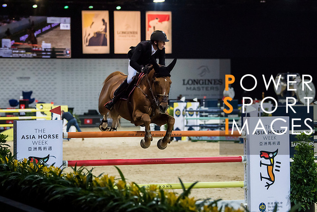 Patrice Delaveau of France riding Aquila HDC competes in the Longines Grand Prix during the Longines Masters of Hong Kong at AsiaWorld-Expo on 11 February 2018, in Hong Kong, Hong Kong. Photo by Zhenbin Zhong / Power Sport Images