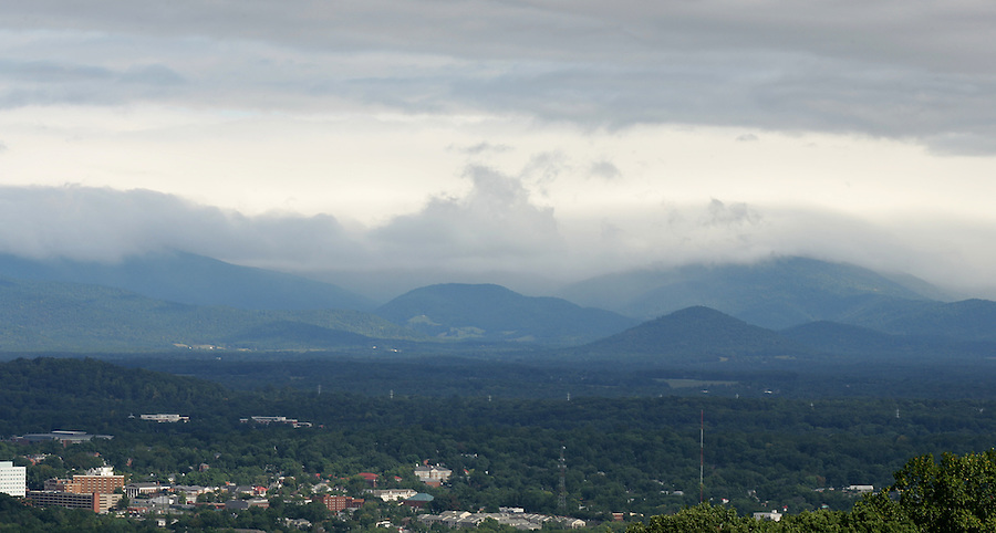 the Blue Ridge Mountains rise up behind Charlottesville, Va.