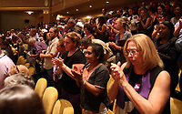Crowd members applaud the words of Susan Bro, mother to Heather Heyer, during a memorial for her daughter Wed., August 16, 2017, at the Paramount Theater in Charlottesville, Va. Heyer was killed the previous weekend when a vehicle drove into a crowd of counter-protestors after the Unite The Right rally. Photo/Andrew Shurtleff